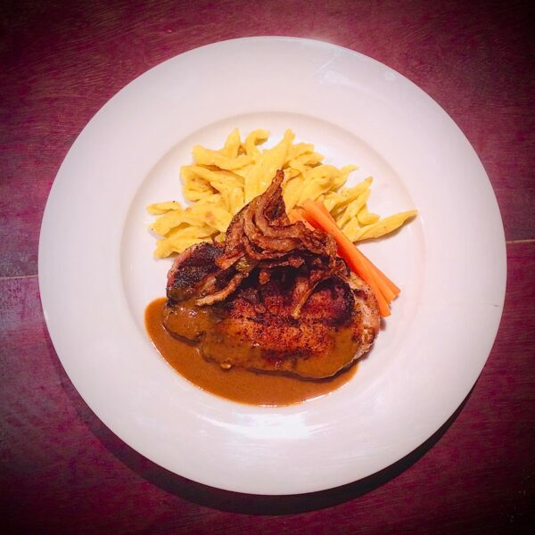Pork loin with roasted onions, glazed carrots and spaetzle